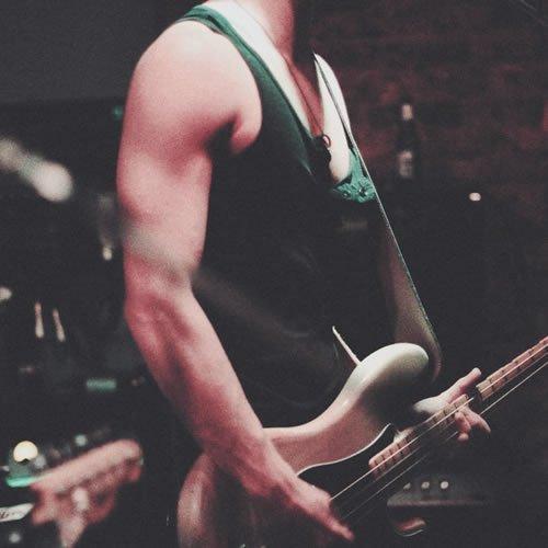 guy holding guitar